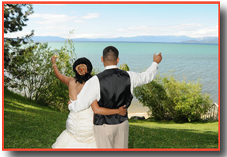 Newlyweds extend champagne glasses to the lake
