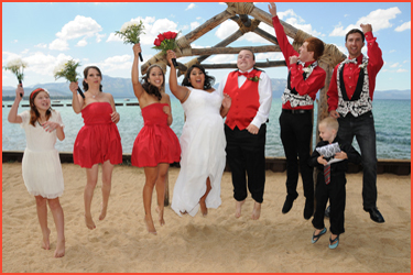Happy bridal party jumping in the air