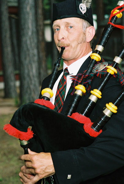 Bagpipe player performing at a wedding