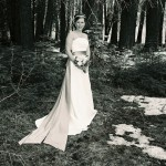 Bride poses in the forest where her wedding took place