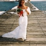 Bride walks acroos the pier prior to her wedding