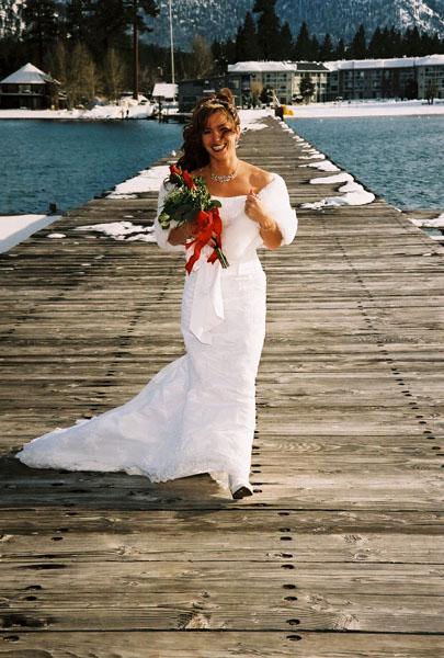 Bride walks acroos the pier prior to her wedding