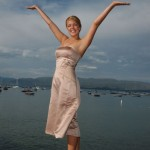 A bridesmaid celebrates on the pier pole