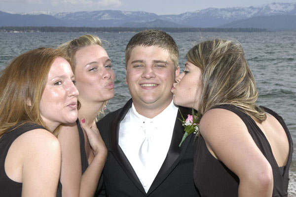 The groom is surrounded by the bridesmaids