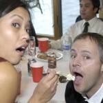 Feeding the wedding cake to each other