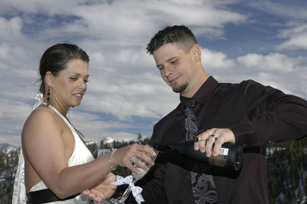 Pouring champagne for a celebrating toast