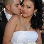 Groom kisses the cheek of his new wife