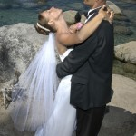 The bride dips her head backwards