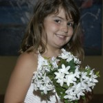 A smiling flower girl with her flowers
