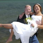 Groom lifts his bride after being pronounced husband and wife