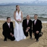 Groomsmen kneel beside the bride