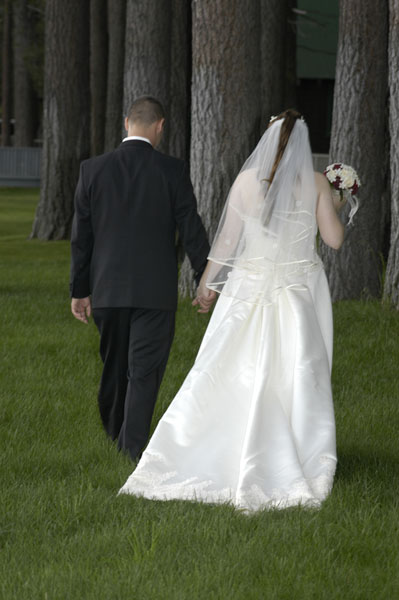 Newlyweds holding hands after their wedding