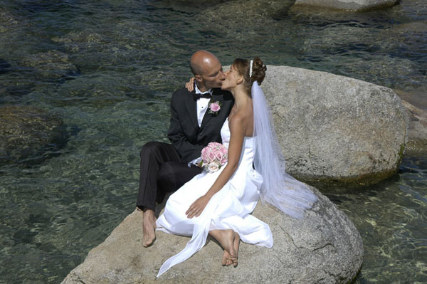 Husband and wife kiss just after being married