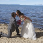Groom gets on his knee to kiss his bride
