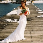 Bride stands on the pier prior to the ceremony