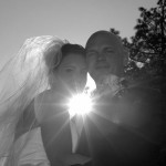 The sun causes silhouetting of the posing couple