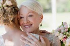 Mother of the bride hugs her daughter