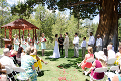 Ceremony taking place between the tree and gazebo at Tahoe Paradise Park