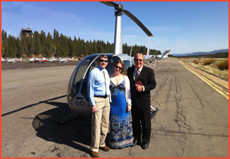 Minister poses on tarmac with couple