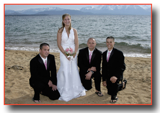 Bride on the beachfront with groomsmen
